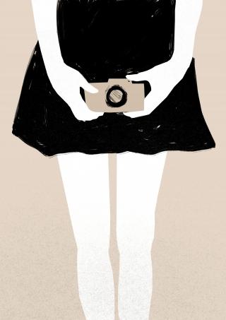 Girl holding a camera.jpg