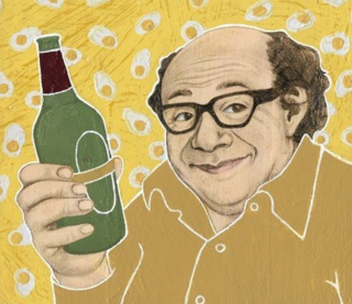 Danny DeVito holding bottle of wine