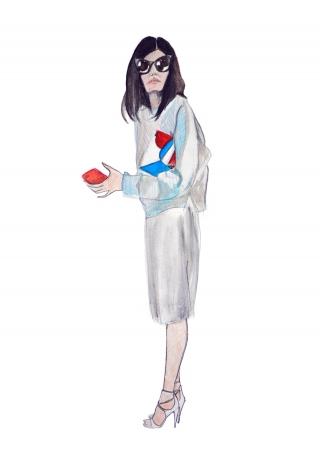 A stylish woman wearing silver skirt, during Paris fashion week