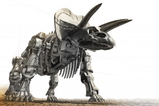 A dinosaur robot made in the shape of triceratops skeleton.