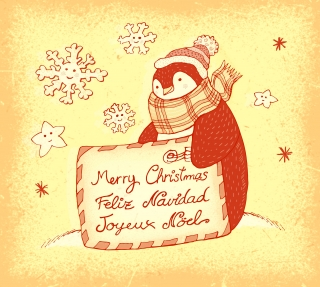 Penguin with Christmas card in winter