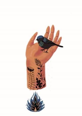 Tattooed hand with a bird