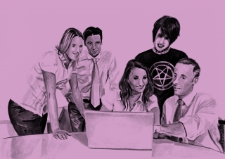 An office of people looking at a laptop screen and one of them is a goth