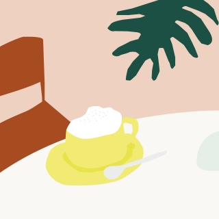 There is a cup of cappuccino on the table setting in a calm and a comfy mood.jpg