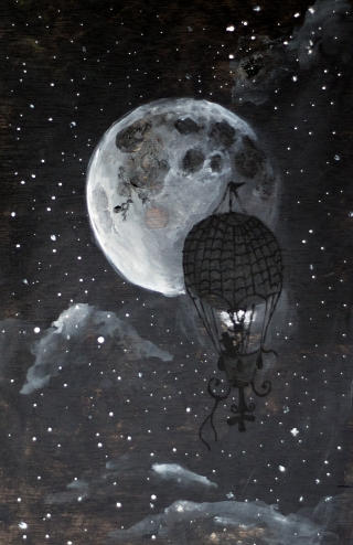 Ballon on the night sky with the moon
