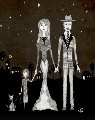 Family at night holding hands with a village in the background.jpg