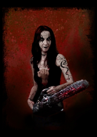 tattooed girl with bloody chainsaw.jpg