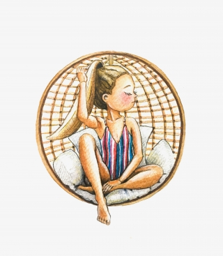 Girl sitting on rattan chair