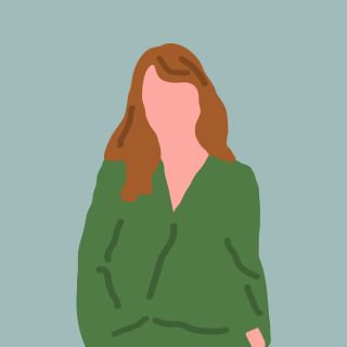 Woman with brown hair wearing green