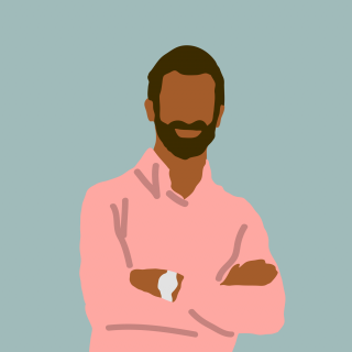 Man with dark hair and beard wearing a salmon shirt.png