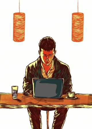 Young millenial working on his laptop in a cafe