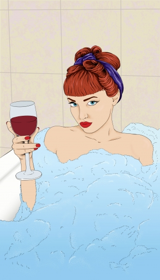 Girl with glass of wine in the bathtub