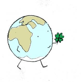 Erde mit Glücksklee in der Hand Hoffnung dream for a good world