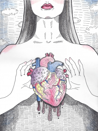 Woman is holding an anatomical heart