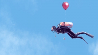 Sky diver diving with a baloon