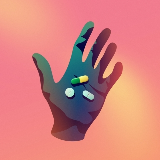 Hand holding drug pills in neon lights.jpg