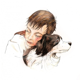 Boy hugging his Border Collie dog