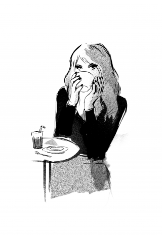 Girl sitting in a café, drinking a coffee