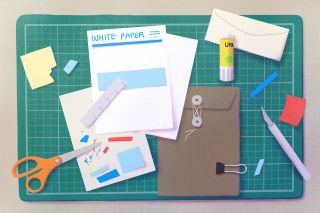 stationary, paper, envelope, scissor, glue, post-its on cutting board.png
