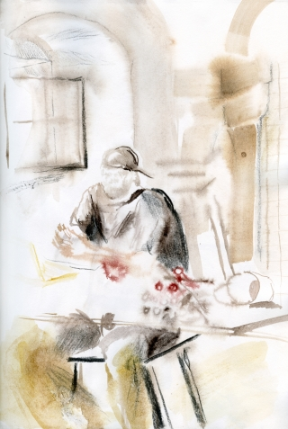 man in studio sitting at the working table.jpg