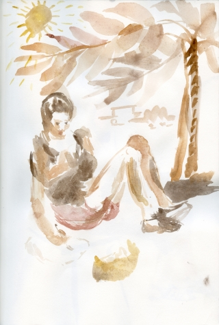 girl drawing under a palm tree enjoying the sun away from the city noise