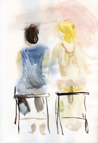two girls having a talk sitting on chairs with the back at the viewer