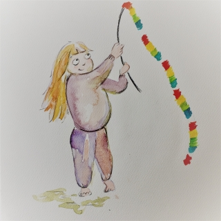 Young blonde girl playing with toy snake