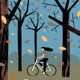 Girl riding bycicle in the forest