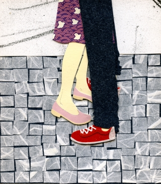 Fragment of a girl and a boy embracing on a street.