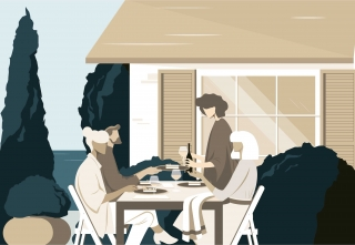 Time to share. Four friends eating together outdoors, in the garden of a house near the sea. (Breathe UK magazine editorial collaboration)