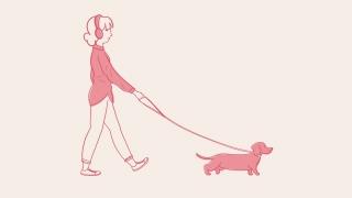 Girl walking dog while listening to music