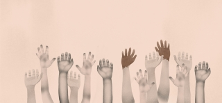group of multi racial children's hands up