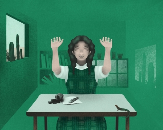 girl at school classroom with hands up as she spill the ink on the desk