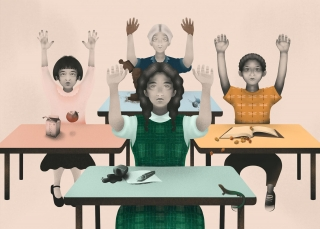 Four children at school classroom with hands up