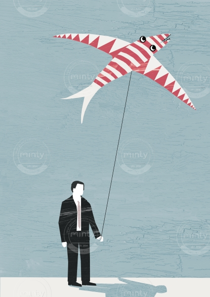 A business man is holding a kite.