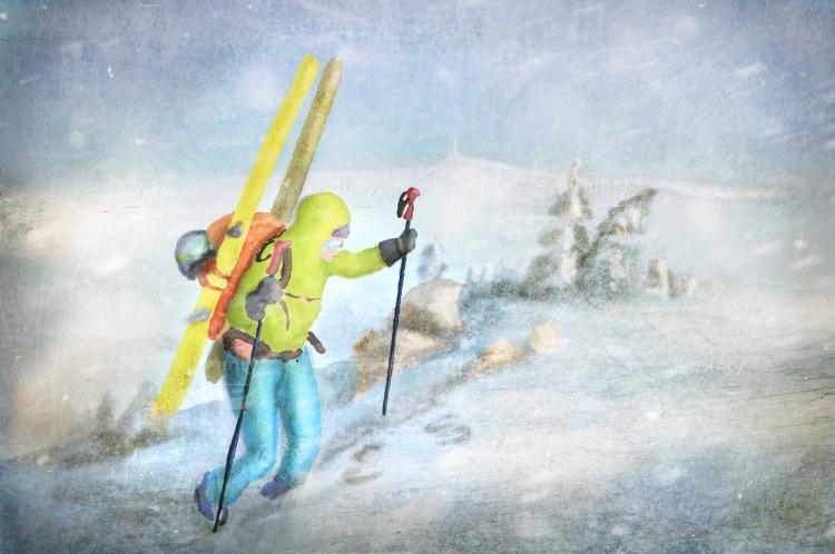 Skialpinist climbing uphill