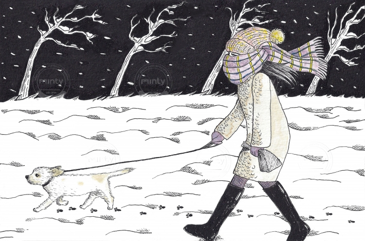 Woman walking her dog in a cold winter night