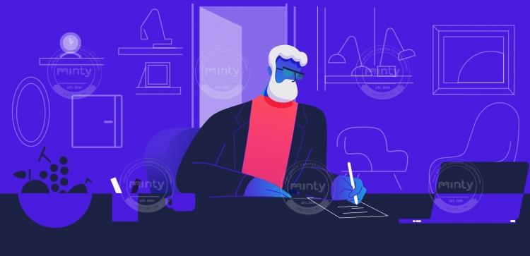 Bearded man sitting on his desk