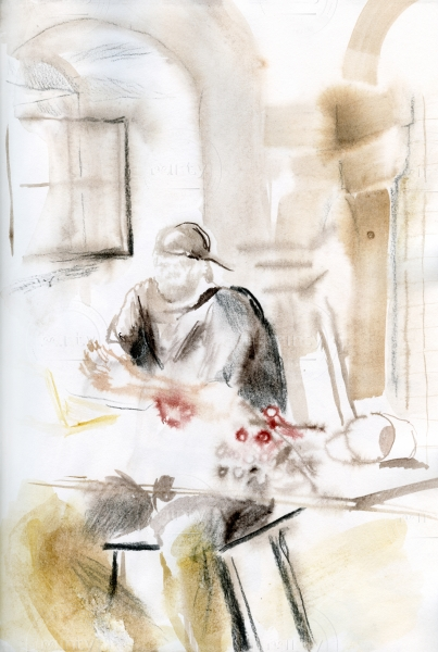 man in studio sitting at the working table