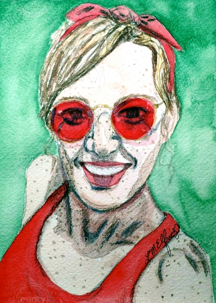 Portrait of a freckled girl with red sunglasses.