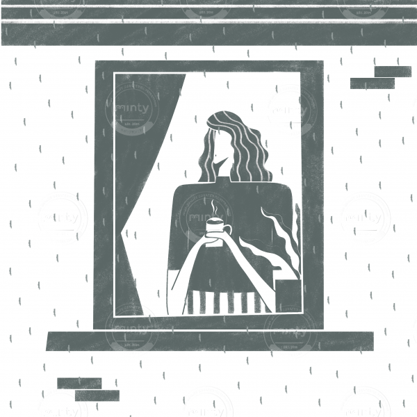 Girl drinking coffee in front of her window on a rainy November day